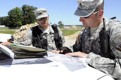 Army Cpt Miller and SSG Burt of the 836 Engineer Company, draw out a plan of action during the CERFP training.