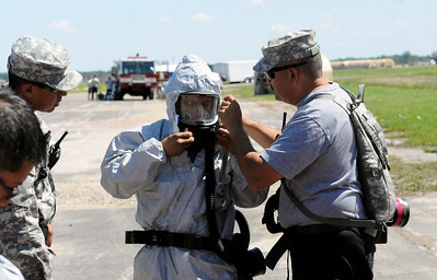 436th Chemical Company change into their hazardous material suits during training for the CERFP Evaluation.