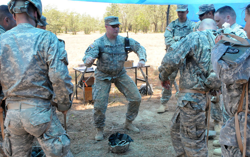 In this image released by the Texas Military Forces, Soldiers with the 836th Combat Engineer Company receive instructions on tying a seat rappel harness at Camp Swift, Texas, Monday, July 25, 2011. The unit participated in the training as part of Joint Task Force 71's Annual Training in preparation to become one of the nation's 10 Homeland Response Forces. As part of the HRF, the unit can work side-by-side with civil response organizations during all types of incidents across FEMA Region 6. (Photo/100th Mobile Public Affairs Detachment, Army National Guard Sgt. Suzanne M. Carter)