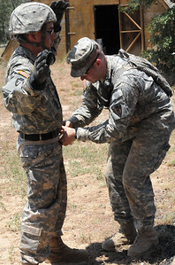 In this image released by the Texas Military Forces, Soldiers with the 836th Combat Engineer Company have their gloves and seat rappel harness inspected before climbing the rappel tower at Camp Swift, Texas, Monday, July 25, 2011. The unit participated in the rappel training as part of Joint Task Force 71's Annual Training in preparation to become one of the nation's 10 Homeland Response Forces. As part of the HRF, the unit can work side-by-side with civil response organizations during all types of incidents across FEMA Region 6. (Photo/100th Mobile Public Affairs Detachment, Army National Guard Sgt. Suzanne M. Carter)