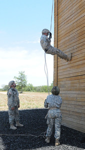 In this image released by the Texas Military Forces, Soldiers with the 836th Combat Engineer Company rappel from a 50-foot tower at Camp Swift, Texas, Monday, July 25, 2011. The unit participated in this training as part of Joint Task Force 71's Annual Training in preparation to become one of the nation's 10 Homeland Response Forces. As part of the HRF, the unit can work side-by-side with civil response organizations during all types of incidents across FEMA Region 6. (Photo/100th Mobile Public Affairs Detachment, Army National Guard Sgt. Suzanne M. Carter)
