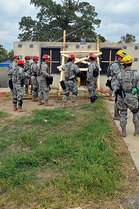 In this image released by the Texas Military Forces, Soldiers and Airmen with Joint Task Force 71 execute search and extraction, chemical decontamination and medical triage operations during the brigade's Homeland Response Force external evaluation Wednesday, October 12, 2011. The brigade participated in the evaluation as the last step in HRF certification, after months of individual online and collective field training exercises in preparation. As a newly certified HRF, the brigade will partner with civil organizations during natural and man-made disasters with chemical, biological, radiological, nuclear and high-yield explosives elements. (Photo/100th Mobile Public Affairs Detachment, Army National Guard Sgt. Suzanne Carter)