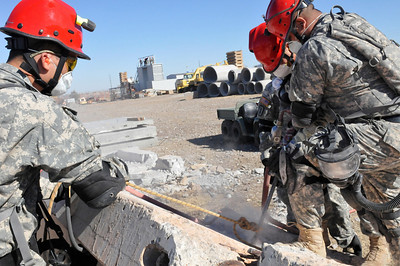 In this image released by the Texas Military Forces, Soldiers from the 836th Engineer Company participate in a collapsed structure extraction exercise in Oklahoma City, Okla., Saturday, Jan. 29, 2011. In addition to its deployed combat mission, the National Guard unit, headquartered in Kingsville, Texas, also trains for stateside emergency situations. Along with other units in Joint Task Force 71, the 836th periodically participates in such training to maximize interoperability when activated to augment civilian public safety entities. (Photo/100th Mobile Public Affairs Detachment, Army National Guard Sgt. Melissa Bright)
