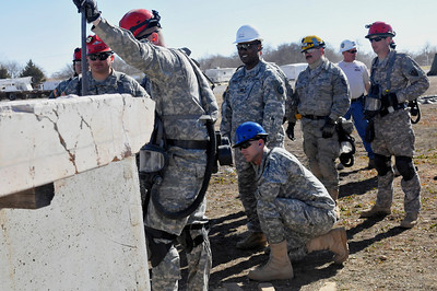 In this image released by the Texas Military Forces, Joint Task Force 71 leaders visit the 836th Engineer Company training site in Oklahoma City, Okla., Saturday, Jan. 29, 2011. Soldiers from the unit, the headquartered in Kingsville, Texas, participated in a collapsed structure extraction exercise. Along with other units in Joint Task Force 71, the 836th periodically participates in such training to maximize interoperability when activated to augment civilian public safety entities. (Photo/100th Mobile Public Affairs Detachment, Army National Guard Sgt. Melissa Bright)
