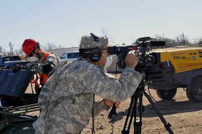 In this image released by the Texas Military Forces, Spc. Richard Castillo facilitates media coverage during a leaders visit to the 836th Engineer Company as they participate in a collapsed structure extraction exercise in Oklahoma City, Okla., Saturday, Jan. 29, 2011. In addition to its deployed combat mission, the National Guard unit, headquartered in Kingsville, Texas, also trains for stateside emergency situations. Along with other units in Joint Task Force 71, the 836th periodically participates in such training to maximize interoperability when activated to augment civilian public safety entities. (Photo/100th Mobile Public Affairs Detachment, Army National Guard Sgt. Melissa Bright)