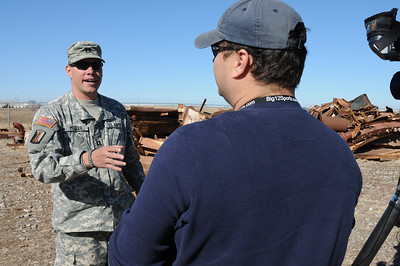 In this image released by the Texas Military Forces, Billy Dry, of Fox 25, interviews Capt. Michael Miller, during a visit to the 836th Engineer Company training site in Oklahoma City, Okla., Saturday, Jan. 29, 2011. Soldiers from the unit, the headquartered in Kingsville, Texas, were there participating in a collapsed structure extraction exercise. Along with other units in Joint Task Force 71, the 836th periodically participates in such training to maximize interoperability when activated to augment civilian public safety entities. (Photo/100th Mobile Public Affairs Detachment, Army National Guard Sgt. Melissa Bright)