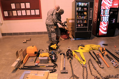 In this image released by the Texas Military Forces, Soldiers with Joint Task Force 71 Soldiers and Airmen with CBRN Enhanced Force Package Task Force run through a vitals check at the Resource Connection in Fort Worth, Tuesday, Feb.1, 2011. The task force, headquartered in Austin, Texas, is in the area as part of a mission to provide support to civil authorities in the weeks leading up to Super Bowl 45. CBRN refers to the threats the unit can encounter, including chemical, biological, radiological and nuclear and encompasses the joint elements of the engineer, chemical and medical units of Joint Task Force 71. (Photo/100th Mobile Public Affairs Detachment, Army National Guard Sgt. Melissa Bright)