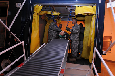 In this image released by the Texas Military Forces, units of the CBRN Task Force assets set up displays inside the drill all of the National Guard armory in Grand Prairie, Texas, Wednesday, Feb. 2, 2011. The TF, based in Austin, established a center of operations with Joint Task Force 71 earlier in the week in the Dallas/Fort Worth area as part of a mission to provide support to Super Bowl 45. CBRNE refers to the threats the unit can encounter, including chemical, biological, radiological and nuclear and encompasses the joint elements of the engineer, chemical and medical units of Joint Task Force 71. (Photo/100th Mobile Public Affairs Detachment, Army National Guard Sgt. Melissa Shaw)
