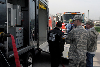 In this image released by the Texas Military Forces, Sgt. 1st Class Anthony Buck and 1st Lt. Brandon Wells with the 6th Chemical, Biological, Radiological and Nuclear Task Force, Joint Task Force 71, joined the Williamson County Hazmat training class in Austin, Texas, Monday, January 23, 2012. The two-week course takes civilian emergency responders through basic and advanced contamination mitigation procedures and is very close to the training JTF-71 receives. JTF-71, headquartered in Austin, use this training to support their primary mission of providing defense support of civilian authorities.  (Photo/ Joint Task Force 71, Army National Guard Staff Sgt. Melissa Bright)