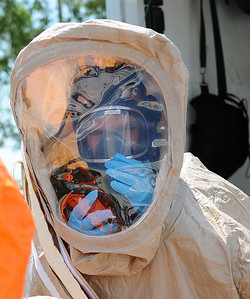 In this image released by the Texas Military Forces, Soldiers with the 6th Civil Support Team practice a joint readiness mission with the College Station Fire Department in College Station, Texas, July 27, 2011.  This collective interagency training is designed to increase operating procedure familiarization. The 6th CST augments first responders in the event of a domestic emergency.  The opportunity to train together prior to emergencies reduces potential challenges and aids in the success of future missions. (Photo/Joint Task Force 71, Army National Guard Spc. Eric Love)