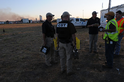 In this image released by the Texas Military Forces, Soldiers and Airmen with the 6th Civil Support Team support local response agencies at a plant fire in Waxahachie, Texas, Tuesday, Oct. 4, 2011. The team responded to a request for assistance from the Texas Commission for Environmental Quality after a chemical fire destroyed much of a facility owned by the Magnablend company. The 6th CST is a National Guard unit based in Austin, Texas and regularly assists civilian officials in detecting and identifying substances released during natural and man-made catastrophic events. (Photo/Joint Task Force 71, Army National Guard Staff Sgt. Melissa Bright)