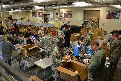 In this image released by the Texas Military Forces Soldiers and Airmen with the 6th Civil Support Team volunteered at the Capitol Area Food Bank in Austin, Texas, Monday, December 12, 2011. The unit, headquartered in the area, provides defense support to civilian authorities in times of need. (Photo provided courtesy of the Capitol Area Food Bank)