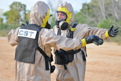 In this image released by the Texas Military Forces, Soldiers with the 6th CST participate in a collective training event during Annual Training, Thursday, July 29, 2011, on Camp Swift, Texas. The team, headquartered in Austin, Texas, specializes in evaluating suspected weapons of mass destruction and other hazards, and joined other members of Joint Task Force 71 to mitigate the effects of simulated chemical spill. (Photo/Joint Task Force 71 Spc. Praxedis Pineda)