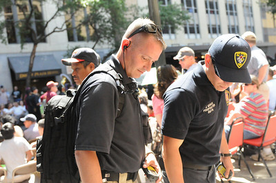 In this image released by the Texas Military Forces, Soldiers with 6th Civil Support Team work with SA Fire Department's Hazmat team during the Battle of Flowers Parade in San Antonio, Friday, April 15, 2001. The five-man team used high-tech radiation detection equipment as part of the city's overall plan to keep its citizens safe during the high-profile event. The CST is responsible for maintaining close relationships with state agencies, enabling them to provide assistance when called upon.  (Photo/100th Mobile Public Affairs Detachment, Army National Guard Staff Sgt. Melissa Bright
