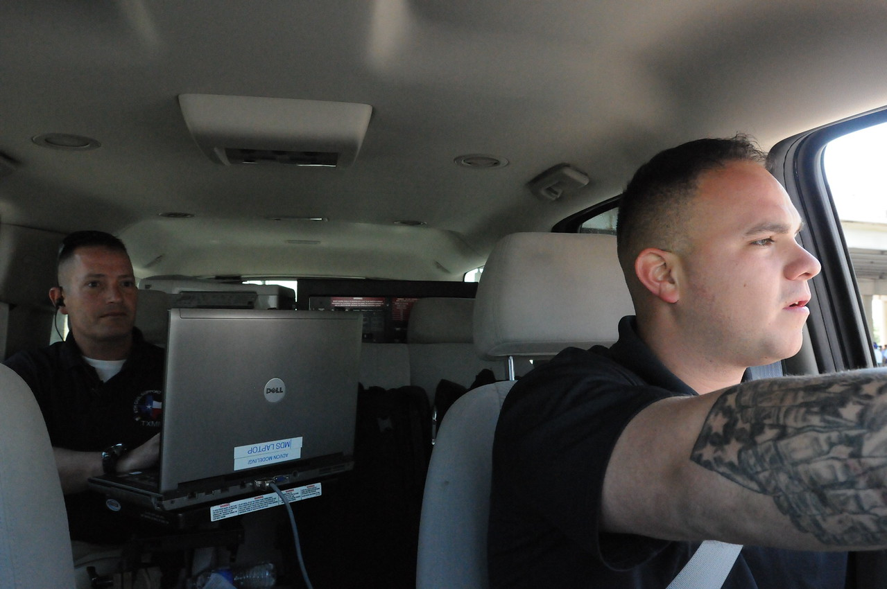 In this image released by the Texas Military Forces, (driving) Spc. Irineo Flores and (back seat) Sgt. John Howard with 6th Civil Support team traverse city streets in a suburban prior to the start of the Battle of Flowers Parade in San Antonio, Friday, April 15, 2001. The five-man team partnered with the SA Fire Department's Hazmat team to use high-tech radiation detection equipment as part of the city's overall plan to keep its citizens safe during the high-profile event. The CST is responsible for maintaining close relationships with state agencies, enabling them to provide assistance when called upon.  (Photo/100th Mobile Public Affairs Detachment, Army National Guard Staff Sgt. Melissa Bright)