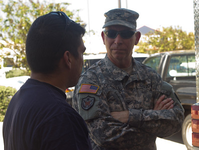 In this image released by Joint Task Force 71 (Maneuver Enhancement Brigade), JTF-71 (MEB) commander Col. Lee Schnell, speaks to a member of the 6th Civil Support Team during their response to the HAZMAT incident in Hutto, Texas, Wednesday, October 17, 2012.