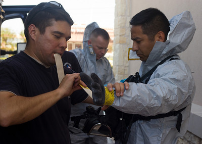In this image released by Joint Task Force 71 (Maneuver Enhancement Brigade), The Texas Army National Guard's 6th Civil Support Team (WMD) responds to a suspicious substance found by local police during a traffic stop in Hutto, Texas, Wednesday, October 17, 2012.