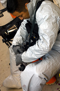 In this image released by Joint Task Force 71 (Maneuver Enhancement Brigade), The Texas Army National Guard's 6th Civil Support Team (WMD) take samples and identify the suspicious substance found by police during a traffic stop in Hutto, Texas, Wednesday, October 17, 2012.