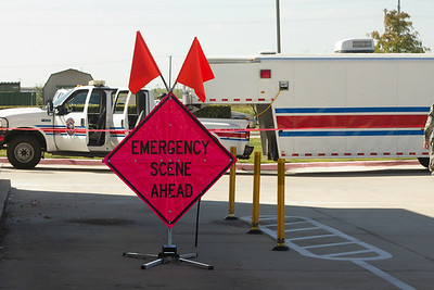 In this image released by Joint Task Force 71 (Maneuver Enhancement Brigade), Williamson County HAZMAT response crews restrict access to a Walgreens parking lot where local police stopped a vehicle with a suspicious chemical substance Wednesday, October 17, 2012.