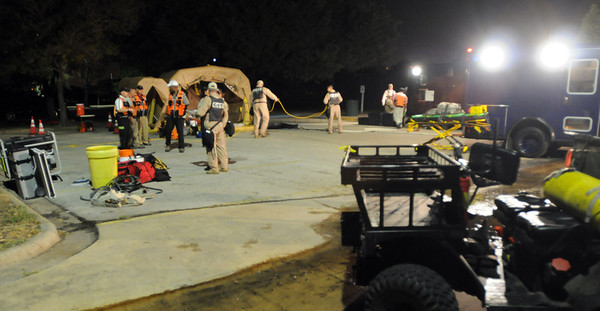 In this image released by the Texas Military Forces, Soldiers and Airmen with 6th Civil Support Team engage in casualty decontamination, chemical detection and hazard containment during the unit's evaluation in College Station, Texas, Friday, October 7, 2011. The unit undergoes evaluation to recertify as a CST every 18 months, ensuring the team keeps its skills fresh. The unit, a federal and state asset, provides support to local first responders during emergencies within the state of Texas, FEMA Region VI, and across the country. (Photo/100th Mobile Public Affairs Detachment, Army National Guard Staff Sgt. Melissa Bright)