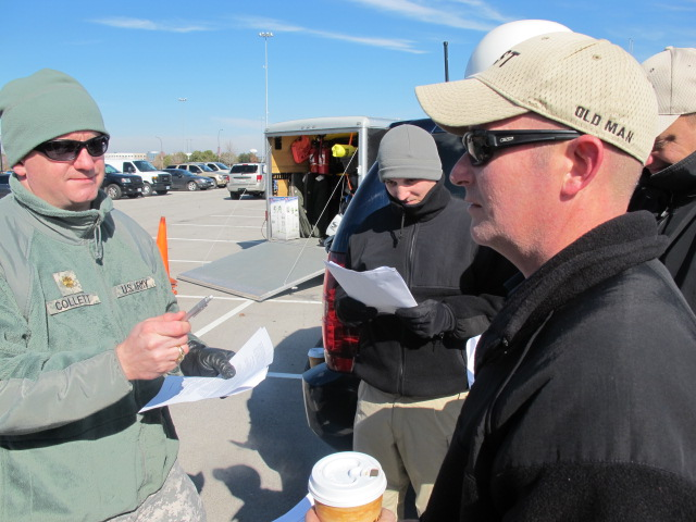 In this image released by the Texas Military Forces, Army National Guard Maj. Adam Collett with the FEMA Region VI Homeland Response Force prepares Soldiers to participate in a media day for public safety entities in Arlington, Texas, Friday, Jan. 21, 2011. The Public Information Office for the Texas-hosted HRF regularly assists units in communicating the story of the Guard's role in stateside operations.  (Photo/Homeland Response Force VI Public Information Office, Army National Guard Staff Sgt. Alfonso Garcia)