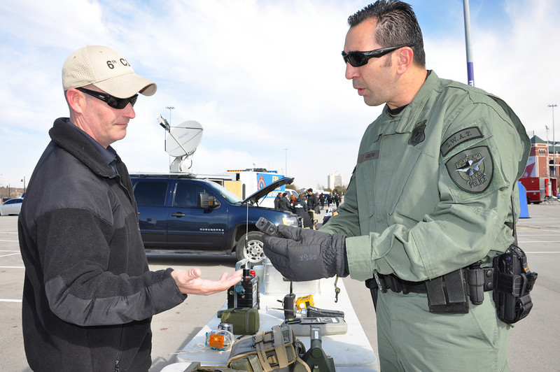 In this image released by the Texas Military Forces, Army National Guard Soldiers from the 6th Civil Support Team exchange information with other public safety entities during a media event in Arlington, Texas, Friday, Jan. 21, 2011. The media day was organized to spotlight the agencies providing support for Super Bowl 45. In addition to helping to communicate with the public, events like this also enhance awareness and interoperability among partner agencies.  (Photo/Homeland Response Force VI Public Information Office, Army National Guard Maj. Adam Collett)
