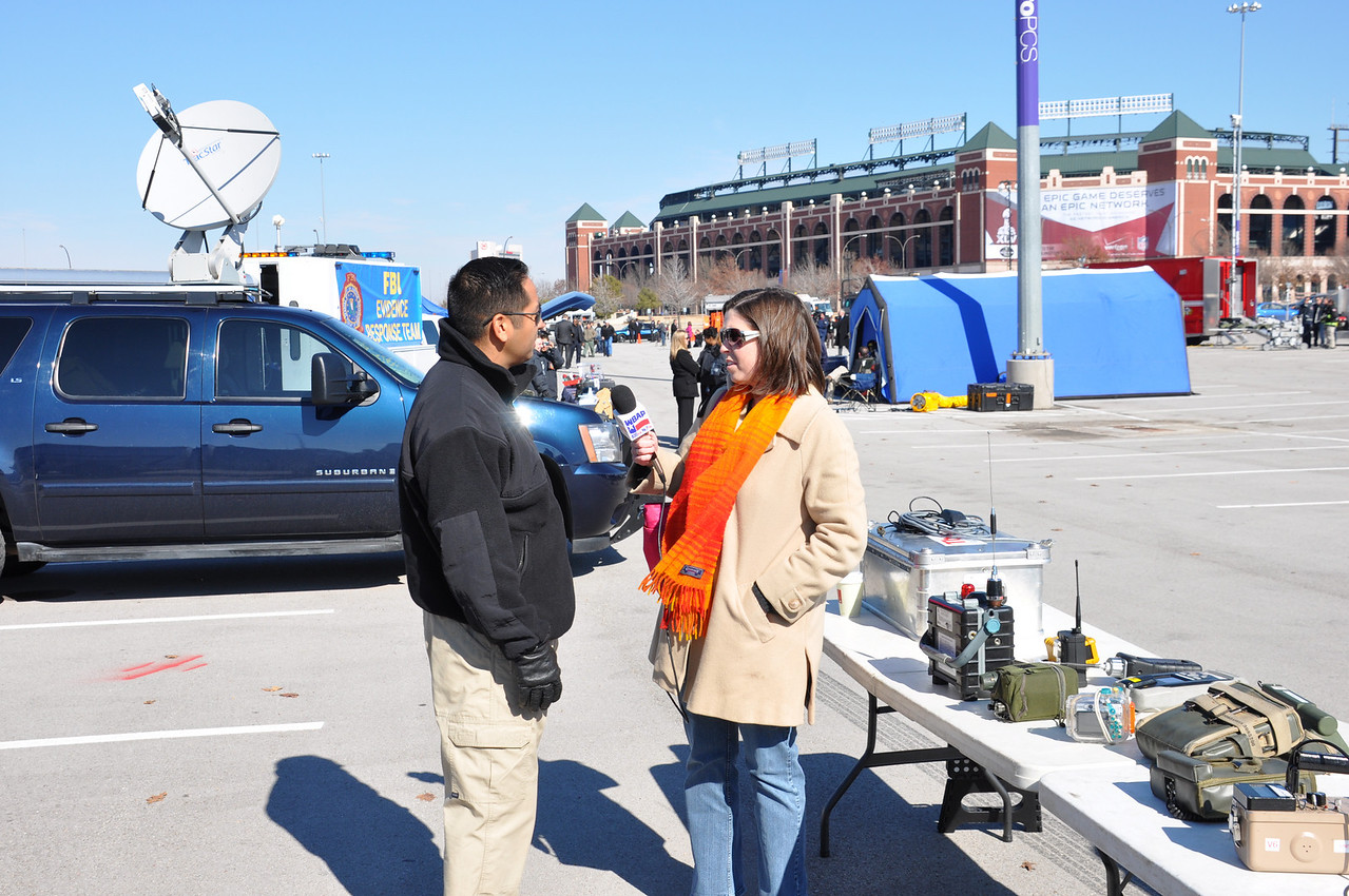 In this image released by the Texas Military Forces, Army National Guard Soldiers from the 6th Civil Support Team interact with members of the civilian media in Arlington, Texas, Friday, Jan. 21, 2011. The Austin-based team was in the Dallas/Fort Worth area for a media day spotlighting agencies providing public safety support before and during Super Bowl 45. Along with other units in Joint Task Force 71, the CST proactively engages with media outlets as a way to keep the public informed about Guard operations.  (Photo/Homeland Response Force VI Public Information Office, Army National Guard Maj. Adam Collett)