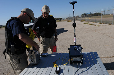 In this image released by the Texas Military Forces, Soldiers and Airmen with the 6th Civil Support Team conduct air monitoring for hazardous chemicals in Waxahachie, Texas, Tuesday, Oct. 4, 2011. The team responded to a request for assistance from the Texas Commission for Environmental Quality after a chemical fire destroyed much of a facility owned by the Magnablend company. The 6th CST is a National Guard unit based in Austin, Texas and regularly assists civilian officials in detecting and identifying substances released during natural and man-made catastrophic events. (Photo/Joint Task Force 71, Army National Guard Staff Sgt. Melissa Bright)