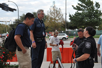 In this image released by the Texas Military Forces, Soldiers and Airmen with the National Guard's 6th Civil Support Team work alongside fire department and other first responders at a World Series baseball game in Arlington, Texas, Saturday, Oct. 22, 2011. Emergency management officials assembled multiple agencies – including the CST – in North Texas to provide proactive public safety support for the event. The CST regularly works with civilian emergency response groups across the state on a variety of events and incidents. (Photo/Joint Task Force 71 Public Information section, Army National Guard Maj. Adam Collett)
