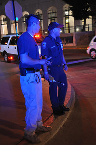 In this image released by the Texas Military Forces, Soldiers and Airmen with the National GuardÕs 6th Civil Support Team work alongside fire department and other first responders at a World Series baseball game in Arlington, Texas, Saturday, Oct. 22, 2011. Emergency management officials assembled multiple agencies Ð including the CST Ð in North Texas to provide proactive public safety support for the event. The CST regularly works with civilian emergency response groups across the state on a variety of events and incidents. (Photo/Joint Task Force 71 Public Information section, Army National Guard Maj. Adam Collett)