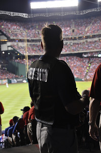 In this image released by the Texas Military Forces, Soldiers and Airmen with the National GuardÕs 6th Civil Support Team provide area monitoring and other support at a World Series baseball game in Arlington, Texas, Saturday, Oct. 22, 2011. The Austin-based unit was deployed to North Texas at the request of civilian emergency management officials to help augment the overall public safety effort for the event. The CSTÕs training and equipment help authorities detect and prevent dangerous substances from being introduced into large crowds.  (Photo/Joint Task Force 71 Public Information section, Army National Guard Maj. Adam Collett)