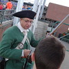 6th Middlesex Regiment member Jim Curley shows the different parts of a musket to a curious fan. Photo by Mary Leach
