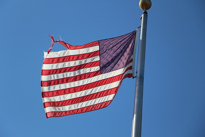 Old and worn flag prior to replacement ceremony.