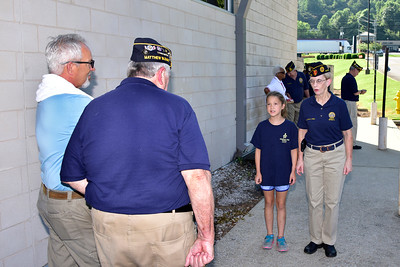 Hailey Huggins learns commands under watchful eye of legionnaire, Steve Smith and Commander Tom McDaniel.