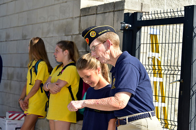 Nancy Waller instructs camper, Hailey Huggins, on ceremony procedures.