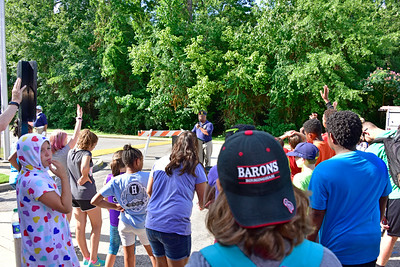 Kenneth Paschal quizes campers on their knowledge of the US Flag as a teaching exercise .