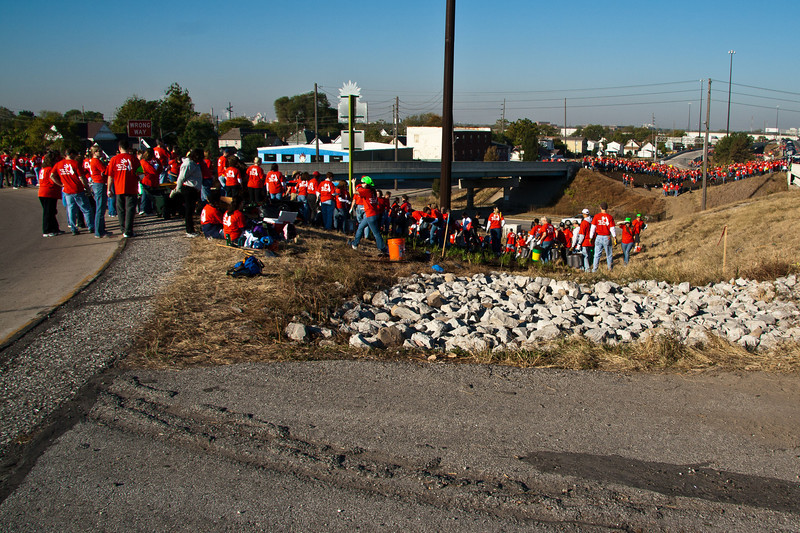 "The 2010 Lilly Global Day of Service focused on the six-mile I-70 corridor running from the airport through downtown Indianapolis. <a href=""http://www.kibi.org/"">Keep Indianapolis Beautiful, Inc.</a> (KIBI) a local nonprofit with a 30-year track record of successful beautification partnerships in Indianapolis, envisioned something much grander than the usual highway ramps. Bringing together the city of Indianapolis, the Indiana Department of Transportation, community leaders, neighborhood groups, and the private sector, KIBI coordinated a master planning process for the corridor with the landscape architecture firm <a href=""http://www.bdmd.com/"">Browning Day Mullins Deerdorf</a>. The project culminated in the 2010 Eli Lilly Day of Service, where over 8,000 Lilly employees added low maintenance vegetation, planted trees, and positioned totem poles and lotus leaf sculptures, transforming the I-70 corridor. The $1 million TE grant supporting the project was matched by an additional $1 million from Eli Lilly in addition to the volunteer labor, a major private investment on behalf of public infrastructure.  Learn more about this extraordinary project at  http://www.agreenerwelcome.org/."