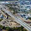 "An aerial photo of the downtown interchanges.   The 2010 Lilly Global Day of Service focused on the six-mile I-70 corridor running from the airport through downtown Indianapolis. <a href=""http://www.kibi.org/"">Keep Indianapolis Beautiful, Inc.</a> (KIBI) a local nonprofit with a 30-year track record of successful beautification partnerships in Indianapolis, envisioned something much grander than the usual highway ramps. Bringing together the city of Indianapolis, the Indiana Department of Transportation, community leaders, neighborhood groups, and the private sector, KIBI coordinated a master planning process for the corridor with the landscape architecture firm <a href=""http://www.bdmd.com/"">Browning Day Mullins Deerdorf</a>. The project culminated in the 2010 Eli Lilly Day of Service, where over 8,000 Lilly employees added low maintenance vegetation, planted trees, and positioned totem poles and lotus leaf sculptures, transforming the I-70 corridor. The $1 million TE grant supporting the project was matched by an additional $1 million from Eli Lilly in addition to the volunteer labor, a major private investment on behalf of public infrastructure.  Learn more about this extraordinary project at  http://www.agreenerwelcome.org/."
