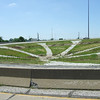 "The future site of public art designed by Biagio Azzarelli at the Meridian Street Interchange.  The 2010 Lilly Global Day of Service focused on the six-mile I-70 corridor running from the airport through downtown Indianapolis. <a href=""http://www.kibi.org/"">Keep Indianapolis Beautiful, Inc.</a> (KIBI) a local nonprofit with a 30-year track record of successful beautification partnerships in Indianapolis, envisioned something much grander than the usual highway ramps. Bringing together the city of Indianapolis, the Indiana Department of Transportation, community leaders, neighborhood groups, and the private sector, KIBI coordinated a master planning process for the corridor with the landscape architecture firm <a href=""http://www.bdmd.com/"">Browning Day Mullins Deerdorf</a>. The project culminated in the 2010 Eli Lilly Day of Service, where over 8,000 Lilly employees added low maintenance vegetation, planted trees, and positioned totem poles and lotus leaf sculptures, transforming the I-70 corridor. The $1 million TE grant supporting the project was matched by an additional $1 million from Eli Lilly in addition to the volunteer labor, a major private investment on behalf of public infrastructure.  Learn more about this extraordinary project at  http://www.agreenerwelcome.org/."