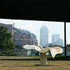 "Lotus leaf structures at the West Street interchange, designed by Shi-Fen Liu.  The 2010 Lilly Global Day of Service focused on the six-mile I-70 corridor running from the airport through downtown Indianapolis. <a href=""http://www.kibi.org/"">Keep Indianapolis Beautiful, Inc.</a> (KIBI) a local nonprofit with a 30-year track record of successful beautification partnerships in Indianapolis, envisioned something much grander than the usual highway ramps. Bringing together the city of Indianapolis, the Indiana Department of Transportation, community leaders, neighborhood groups, and the private sector, KIBI coordinated a master planning process for the corridor with the landscape architecture firm <a href=""http://www.bdmd.com/"">Browning Day Mullins Deerdorf</a>. The project culminated in the 2010 Eli Lilly Day of Service, where over 8,000 Lilly employees added low maintenance vegetation, planted trees, and positioned totem poles and lotus leaf sculptures, transforming the I-70 corridor. The $1 million TE grant supporting the project was matched by an additional $1 million from Eli Lilly in addition to the volunteer labor, a major private investment on behalf of public infrastructure.  Learn more about this extraordinary project at  http://www.agreenerwelcome.org/."