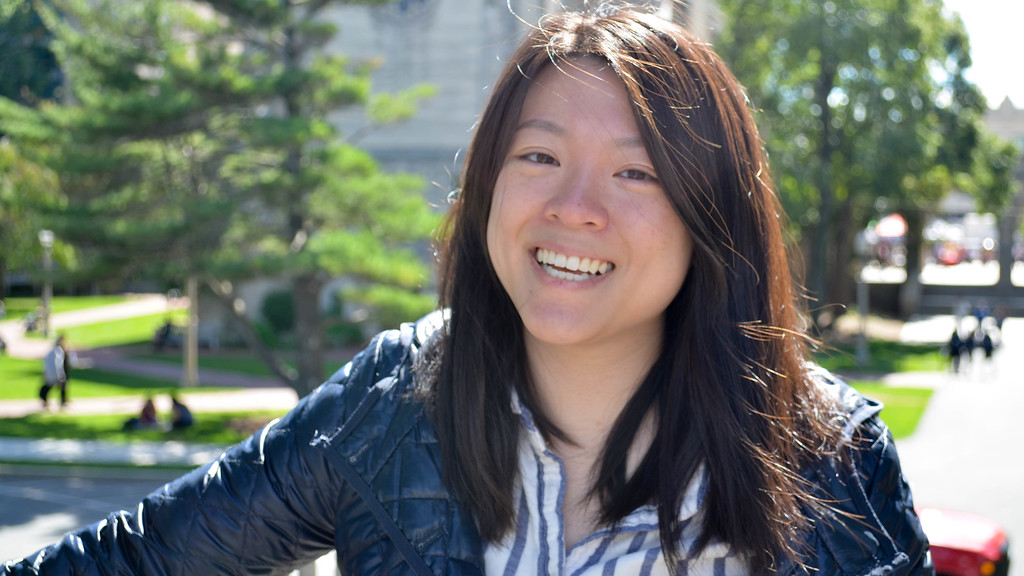 Sarah Toy, graduate student at Boston University poses for a photo near Charles River.