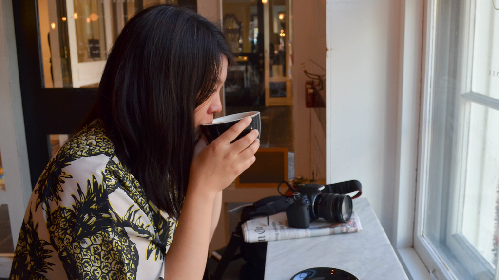 Boston University graduate student, Sarah Toy enjoys come coffee and a pastry at Tatte in Beacon Hill.