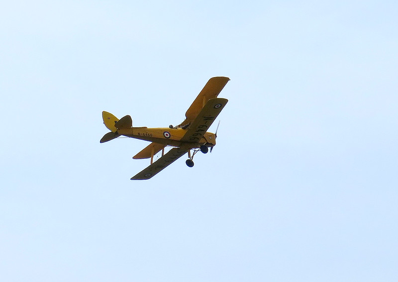 Someone is getting a good view from the Tiger Moth which flew off along the coast towards the West