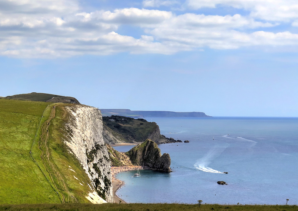 Looking forwards the iconic feature of Durdle Door can be easily seen beyond the mass of Swye Head