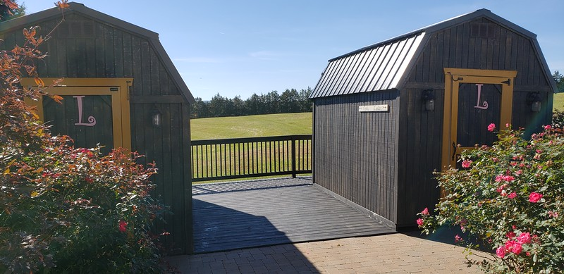 (4) Restrooms behind barn