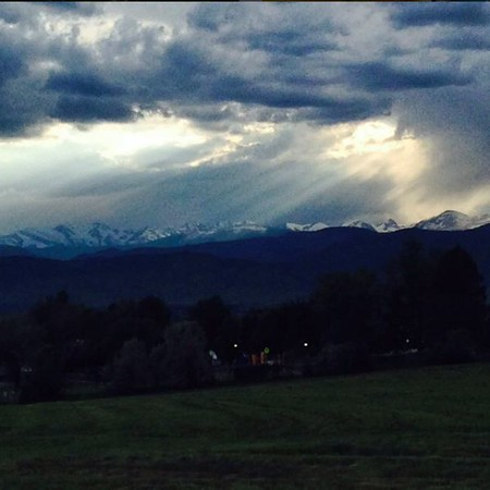 Lights and clouds and Indian Peaks from the open space behind the house