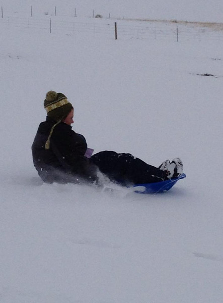 Sledding on the hill across from Heatherwood Elementary