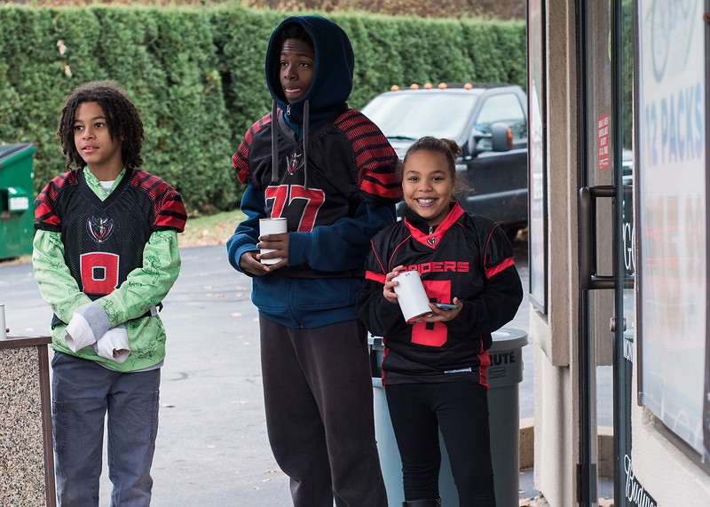 7th grade Fitchburg AYF player Damien Jones, younger sister Zamira, and fellow player Isaiah Jeffreys were fundraising for their potential trip to Disney for Nationals outside Gomes Liquors on Saturday, Nobember 18, 2017. SENTINEL & ENTERPRISE / Ashley Green