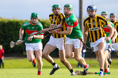 Loughmore Castleiney's John Meagher and Brian McGrath compete with Upperchurch Drombanes Paul Shanahan and Padraig Greene