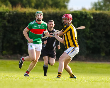 Upperchurch Drombanes Paul Ryan clears the ball, watched by Loughmore Castleiney's Brian McGrath